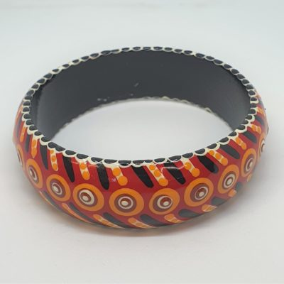 Timber Bangle - Red background, black, white, ochre & yellow design - Jewellery Unique - Irene  Bowyer